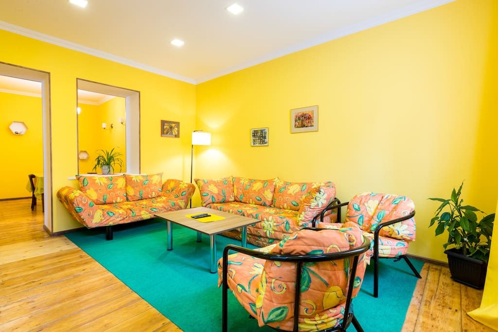 Bright living room with floral sofa<br><br>