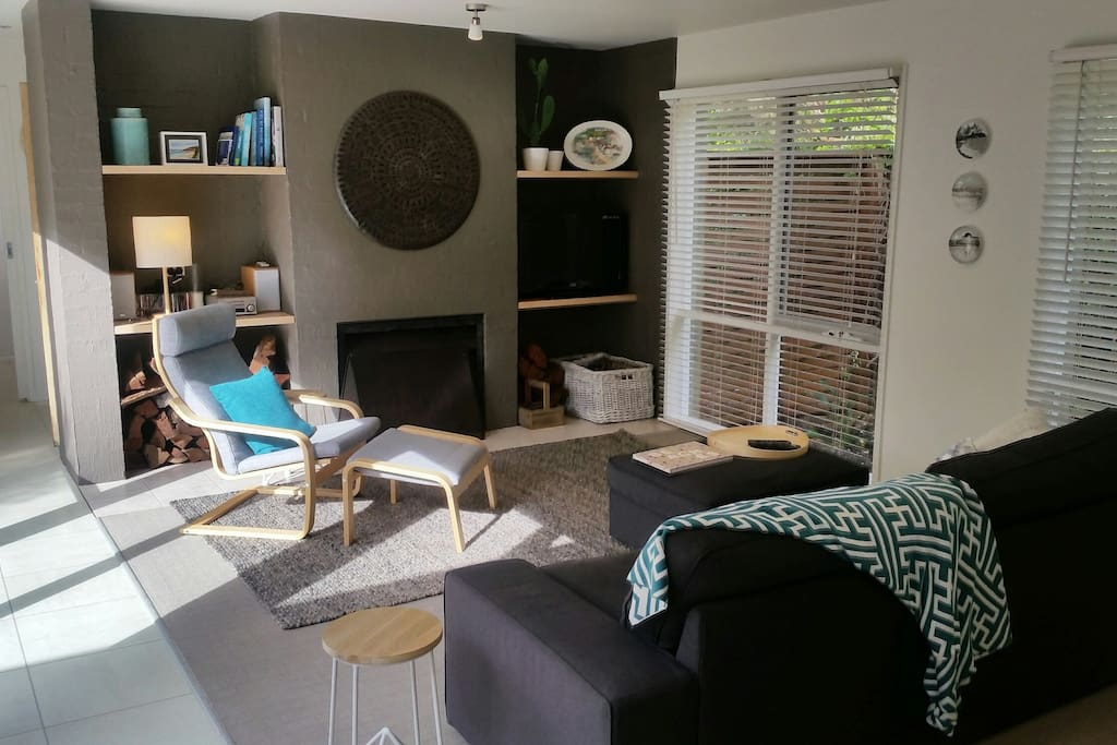 Light filled Second Living room with open fire