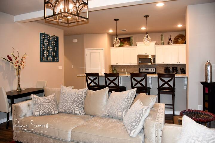 Come relax in the living room. Plenty of seating!