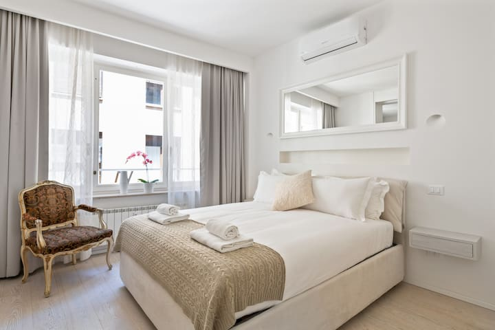 The first Bedroom - The comfortable double bed with soft bed- linen and towels