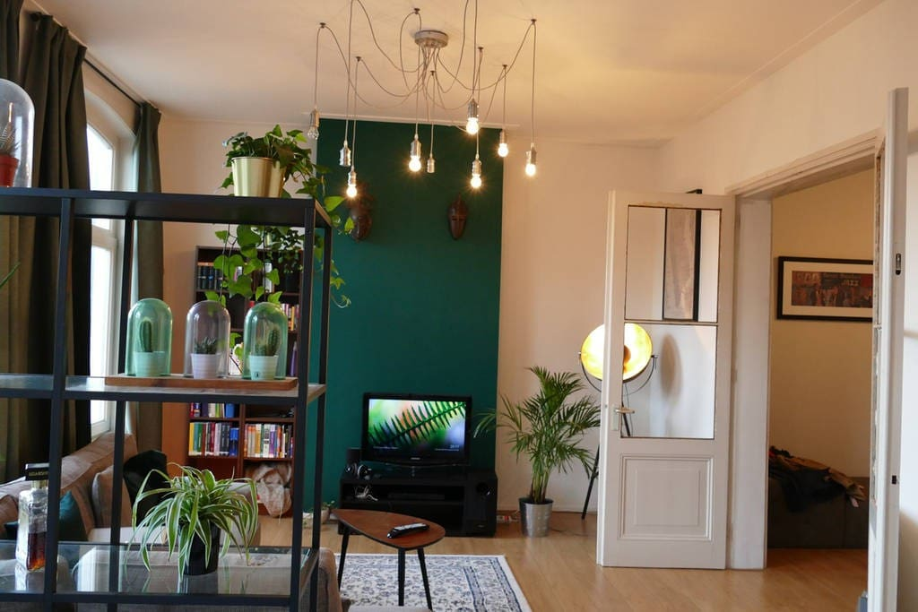 Bright living room with access to ensuite living area with double bed and dining table
