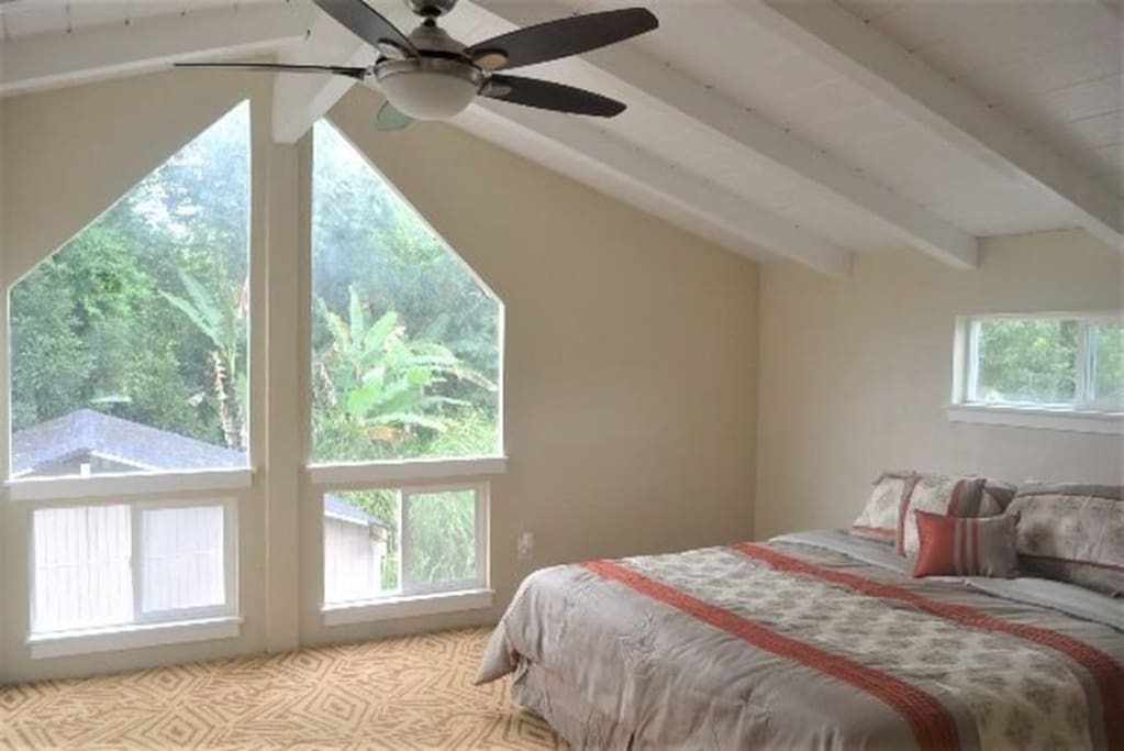 Master Bedroom with privet master bathroom on the second floor with views of lush greesn
