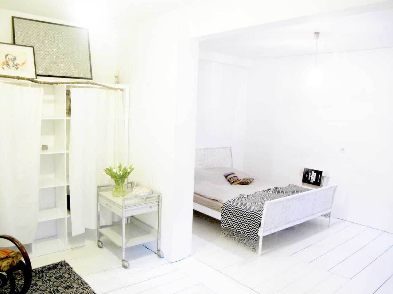 Room overview. Clean spacious room, white and minimal, with few decorative craft elements and bits of Berliner contemporary art and vintage finds.