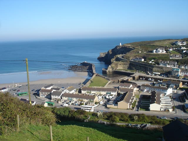 The beach and harbour of Portreath.