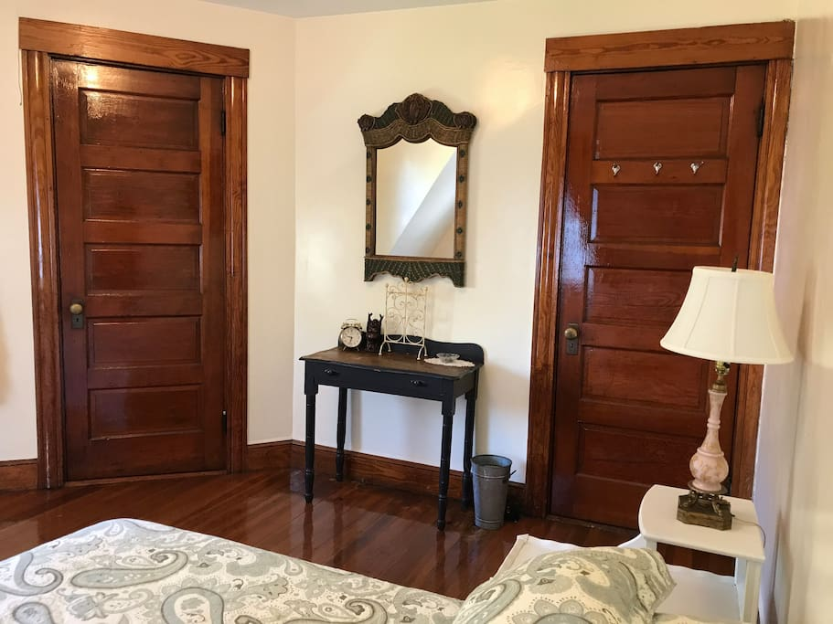 Another view of the guest room ... the left door opens to a small empty closet for you to hang clothing. The right door leads to a small hallway area. The shared bathroom is conveniently located to the left of the guest room.