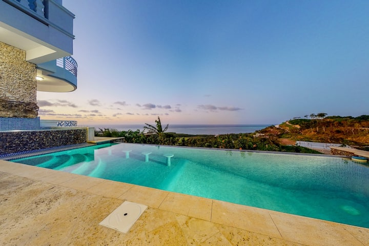Colorful home w/ private pool, great golf and ocean views - walk to the beach!
