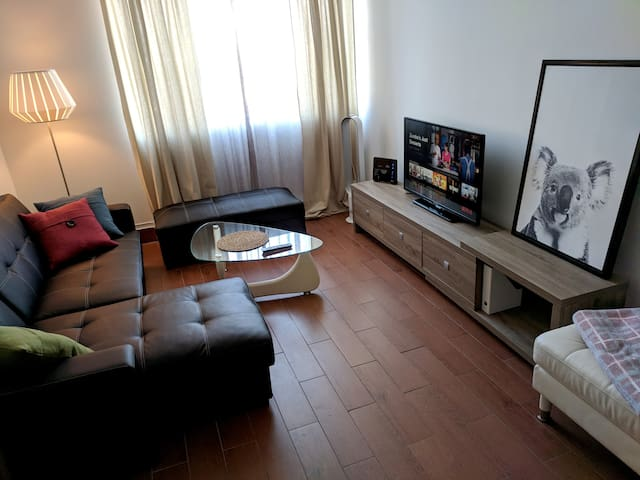 Living room - TV stand has 3 large drawers for storage