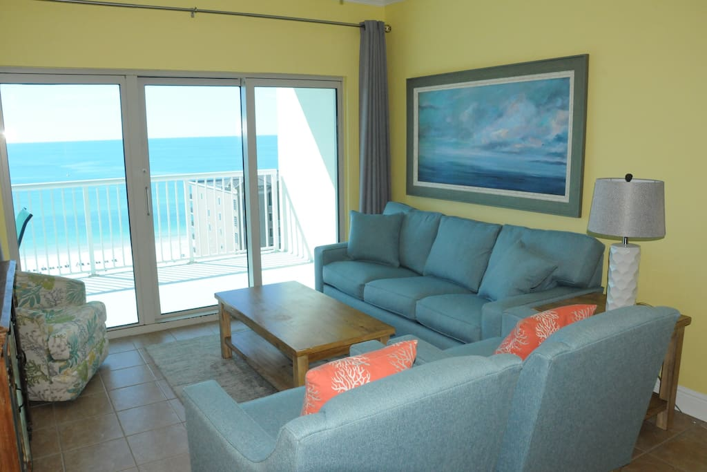 Relax in this updated Living Room while taking in views of the Gulf