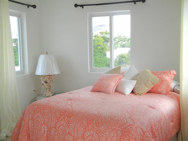 Queen Sized Bed with view windows behind.