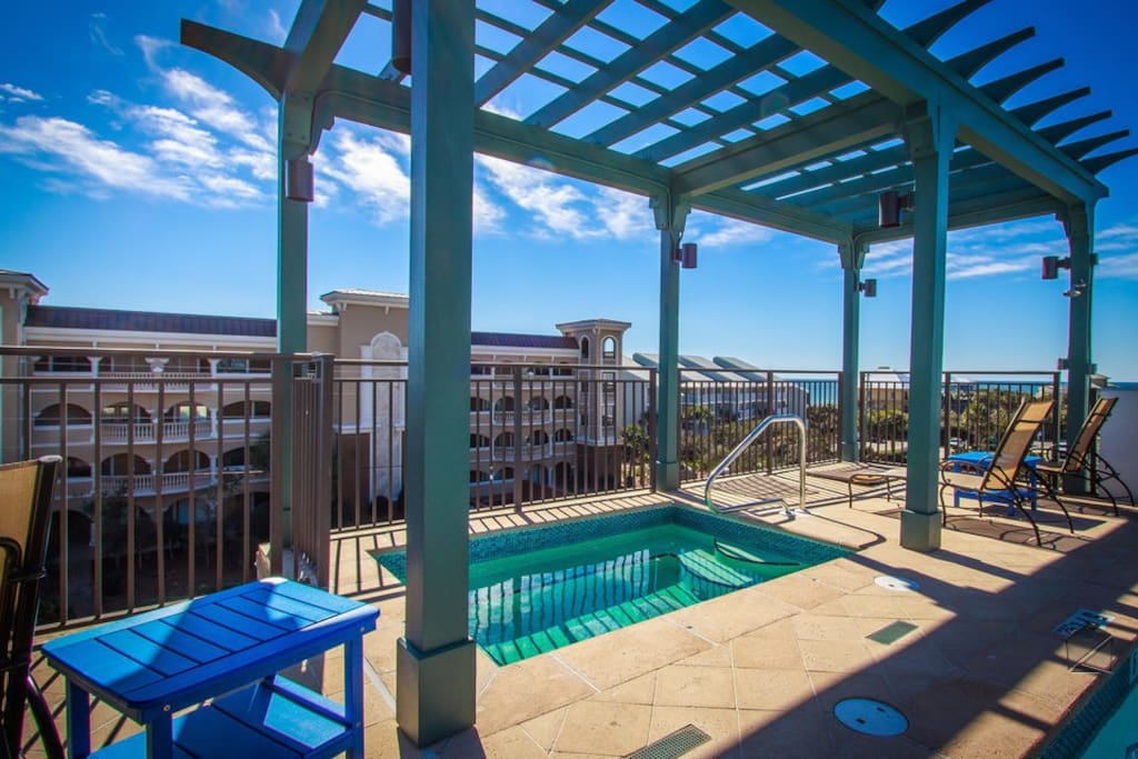 The hot tub, located on the rooftop deck, also features Gulf views.