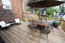 Large private deck with table for 8 and two rocking chairs