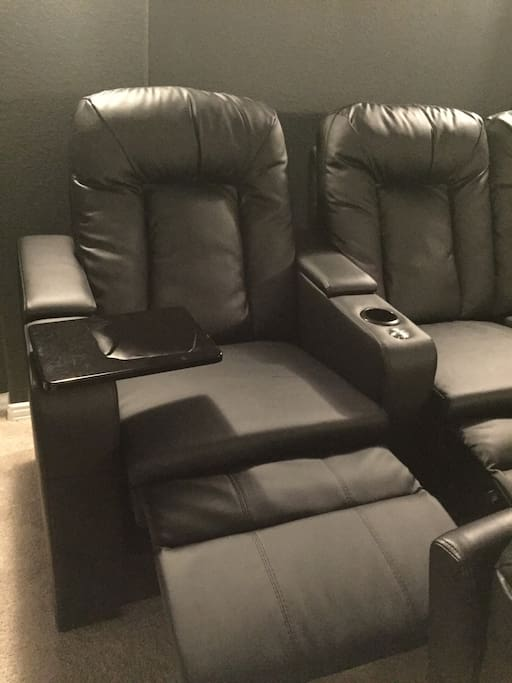 All seats fully recline and have cup holders - back row also has table attachments