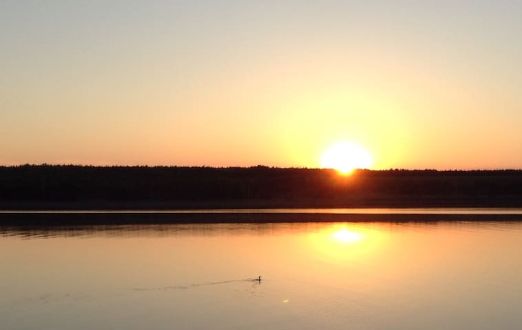 Sunset over Cheticamp Island from Harbourview Suite Patio