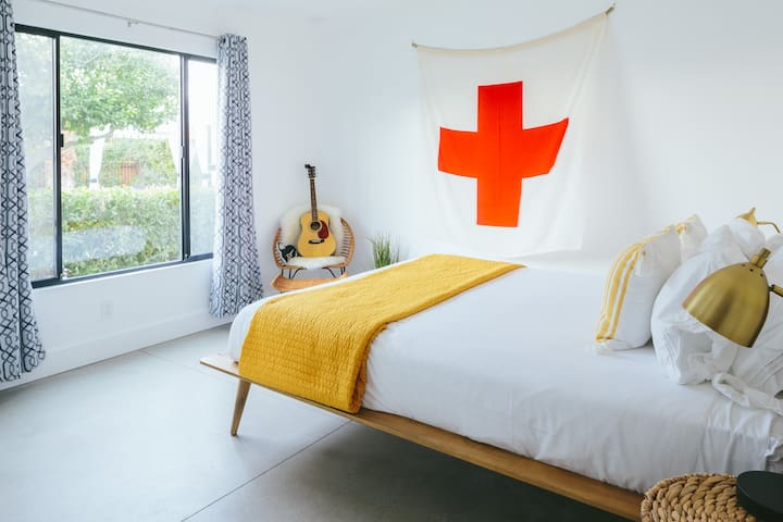 Bedroom of Bungalow 2 (and impromptu first aid station), featuring a comfortable queen bed.