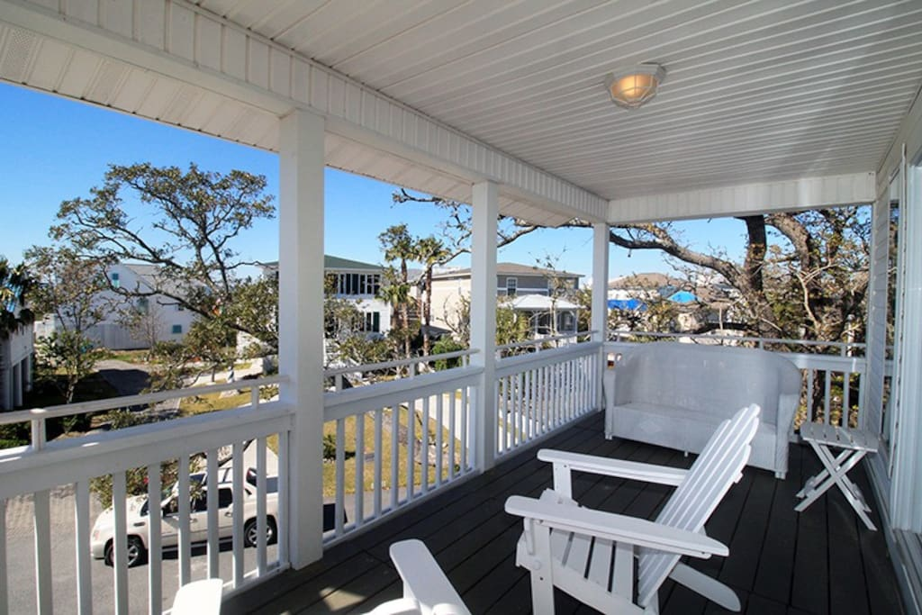 Enjoy coffee or a cocktail on the balconies with a view of Cockspur Lighthouse and the Savannah River entrance.
