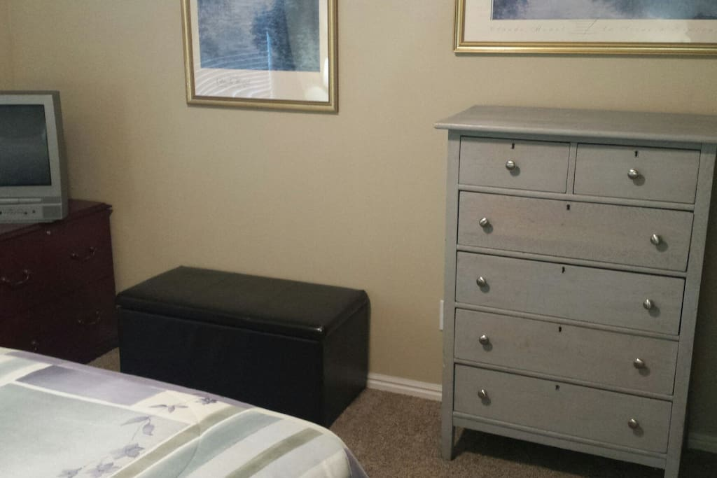 Bedroom with DVD player and a six drawer dresser for your use
