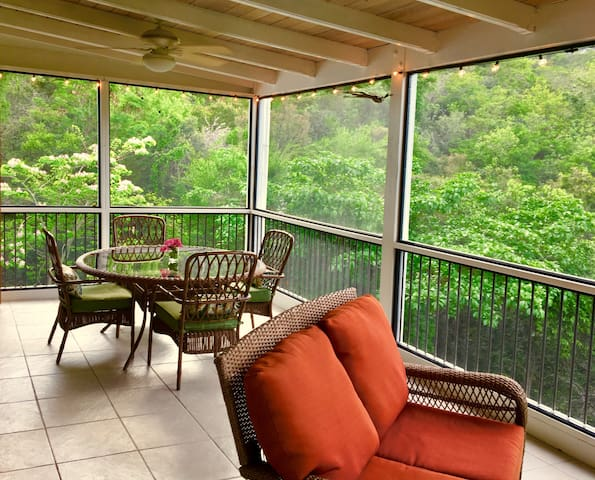 The screened in porch has two ceiling fans and allows guests to enjoy the outdoors year round.