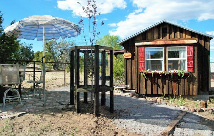 Red door cabin in Cruzville