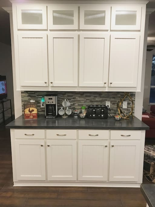 Kitchen Island and cabinets with amenities you might need.