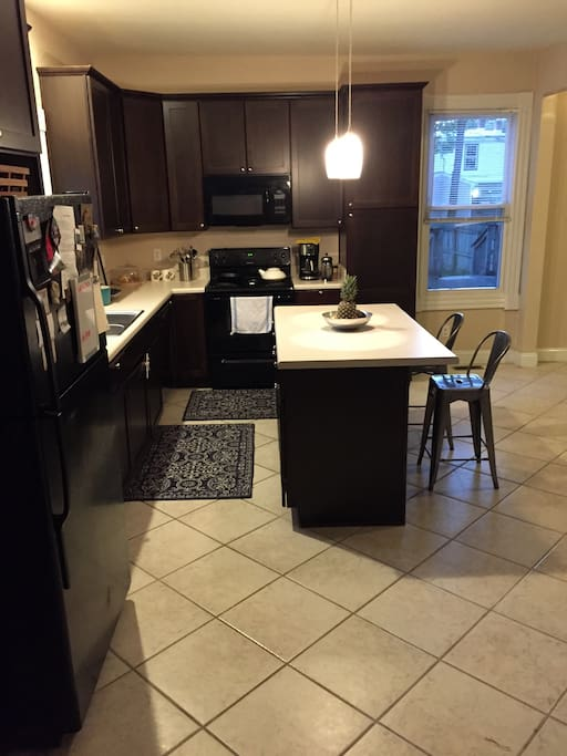 Large eat-in kitchen with dining table and bar
