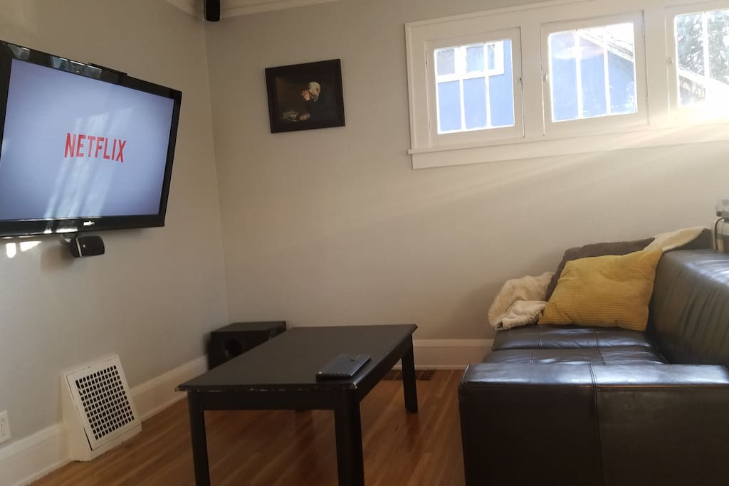 The TV is hooked up to a home theater PC.  Hop on and access any of your online video accounts (Netflix, Amazon, Hulu, Youtube, etc).  The TV is on a large swing arm so it can be viewed from the dining room as well.