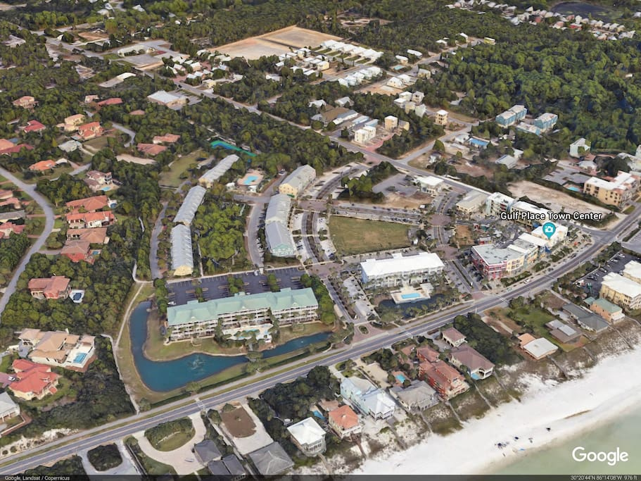 Gulf Place Caribbean is lower left building by pond and green slate roof.