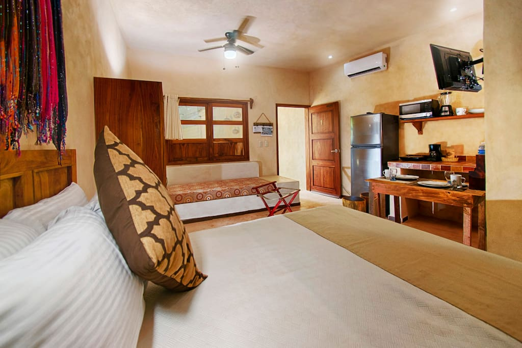 Queen size bed, closet, luggage stand, single bed size sofa, full kitchen, A/C, WIFI, and 43'' Smart tv with satellite service.