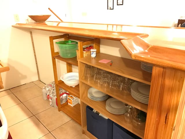 Under-bar storage with dishes and glasses, and more cooking supplies, etc.!