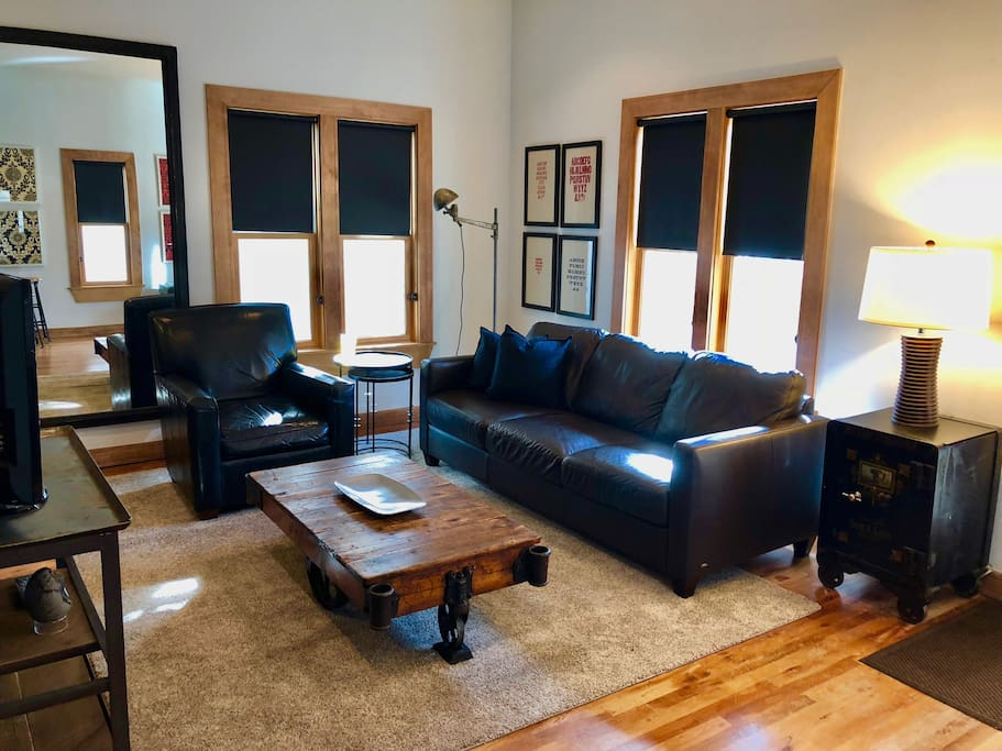 Spread out and relax in our spacious living room with high ceilings.