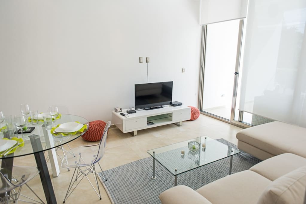 This is the living room, comfortable sofas and also have flat screen tv