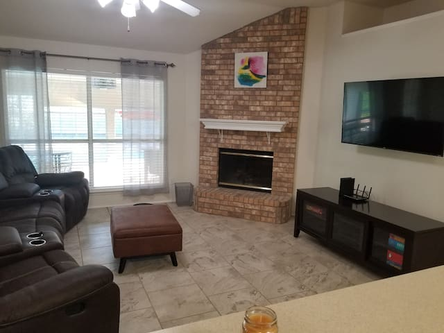 Open floor-plan living room with 4k HD TV.  Amazon, Netflix, and Hulu are just some of the included amenities.   2 of the 4 couches recline, and make TV and movies deeply relaxing to enjoy.