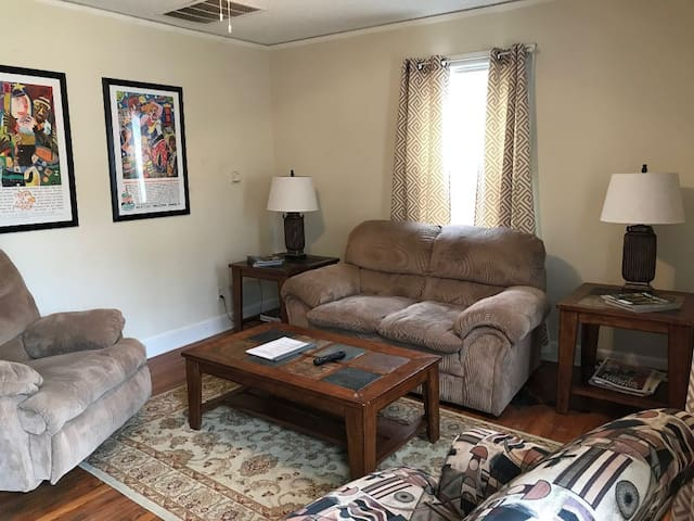 The Cottage Living Room (comfortable couch, easy chair, side chair, end tables, coffee table and cable tv)