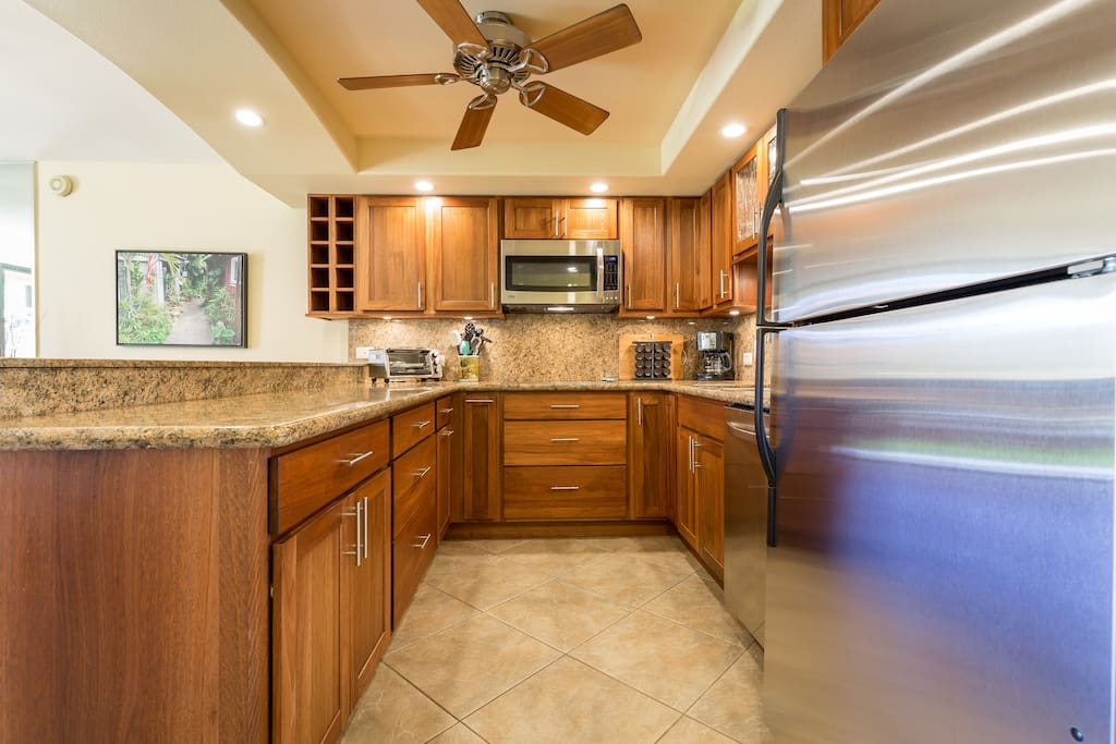 Kitchen Area With Stainless Steel Appliances And A Convection Oven
