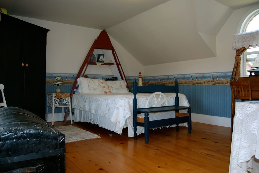 Comfy queen size bed in the real Oyster Boat.