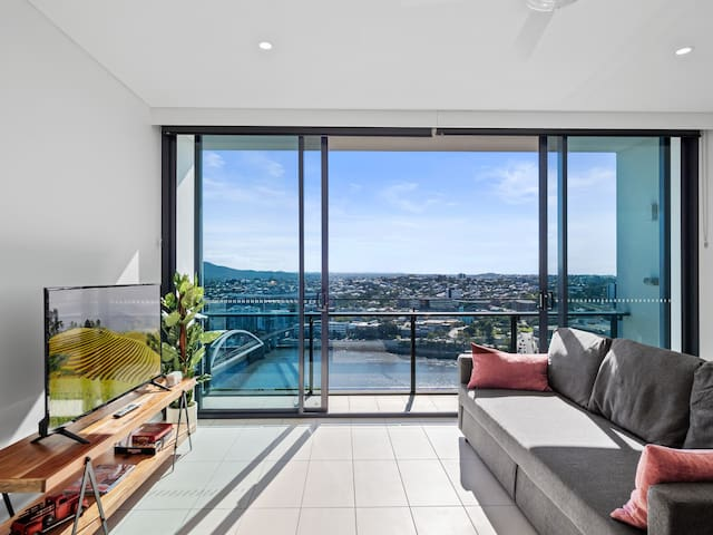 Large bright and cozy living area with spectacular 180 degree river view.