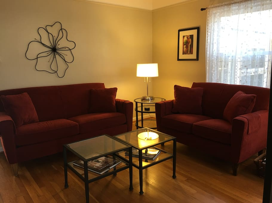Step through the front door into the living room complete with a big screen tv and comfy couches.