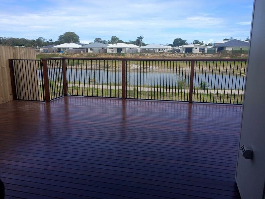 Beautiful outdoor deck overlooks Lake Piccolo.