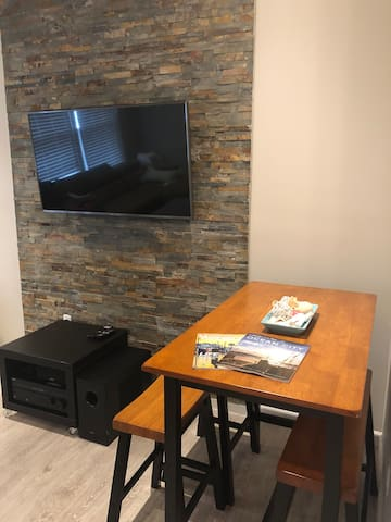 """Dining table, 50"""" LG TV Sony Home Theatre System"""