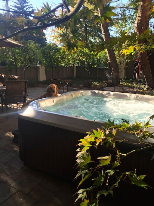 hot tub in private fenced patio area