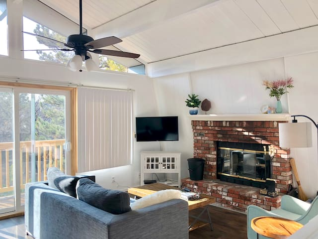 """The upstairs living area, which includes a smart TV to watch your favorite shows or find a new one. """"The place was stylish, clean and had everything to make our stay enjoyable."""" - Lara, guest"""