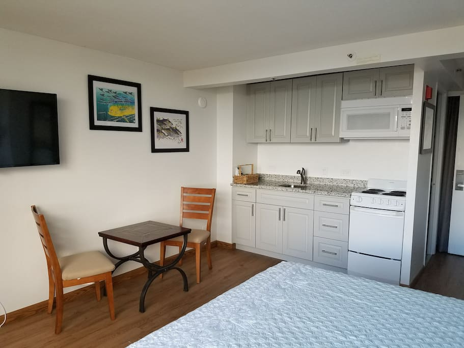 Spacious studio room with queen bed and full kitchen
