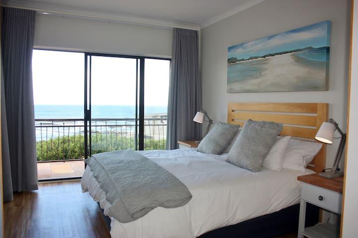 Main bedroom en-suite with King bed extra length, doors open onto balcony