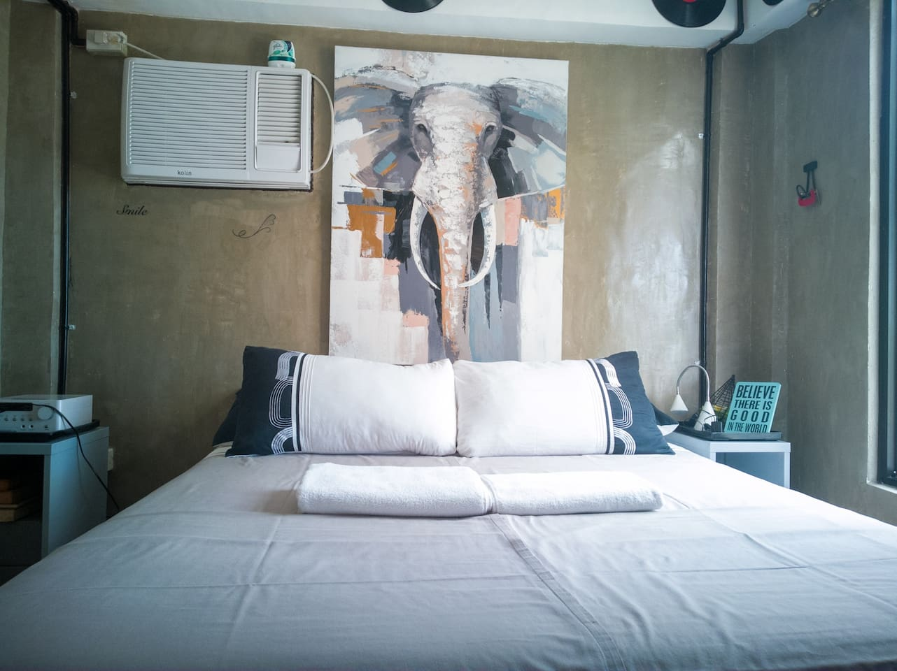 One bedroom apartment with double bed with a TV at the foot of the bed for your movie marathon or if you just need to chill.