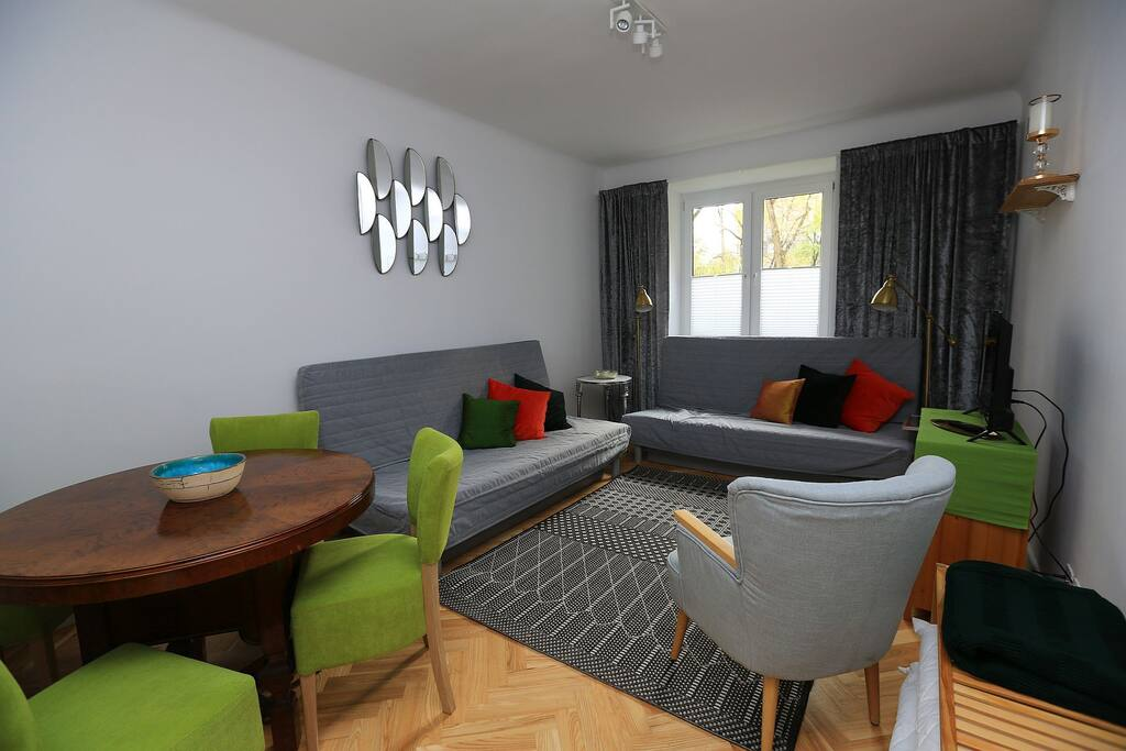 large room with two sofa beds