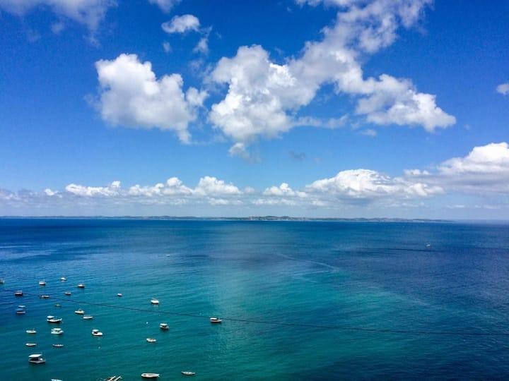 Flat aconchegante e vista mar