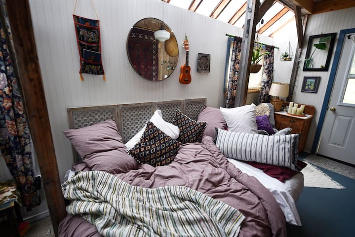 Piles of pillows to lounge on the day-bed (and night-bed!). This is a double bed, not a queen, so best to be snuggly with your bed-partner!