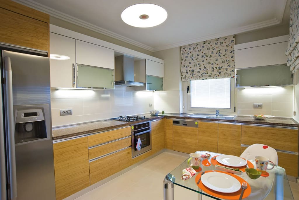 Kitchen equipped with full accessories and electrical devices.