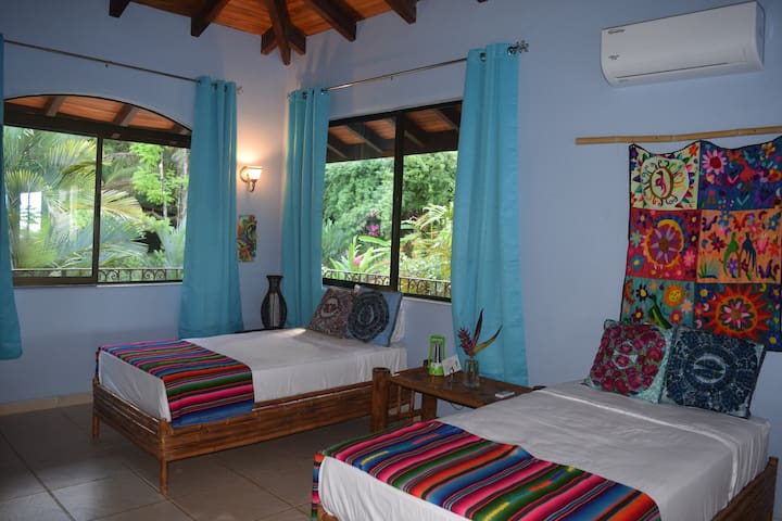 Suite # 9 with 2 single beds, garden views in the main building.
