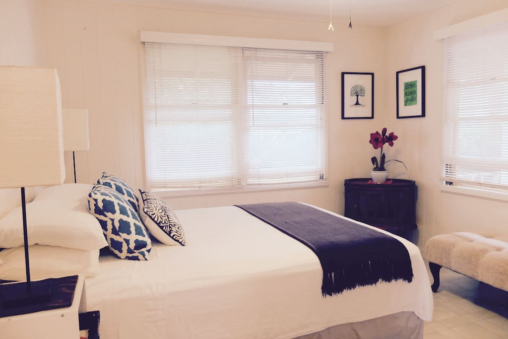 Guest Room 1: Bright and breezy with queen sized bed and ceiling fan