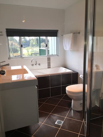 Bathroom with full sized bath and shower recess